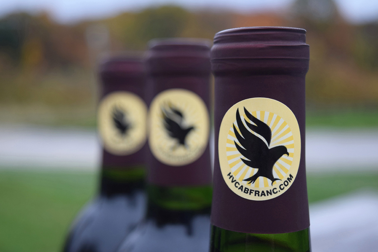 wine bottle necks with hawk logo