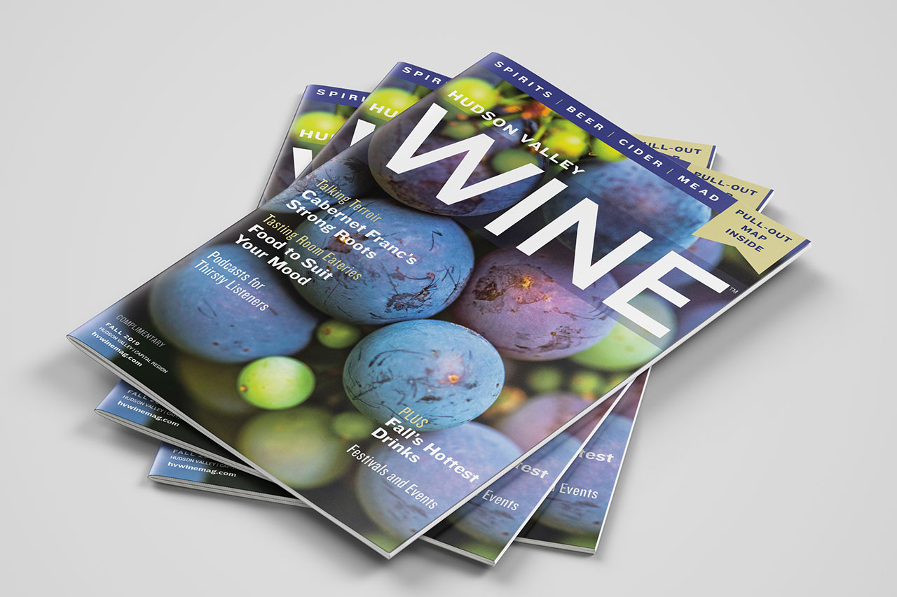 stack of three magazines with grapes on cover