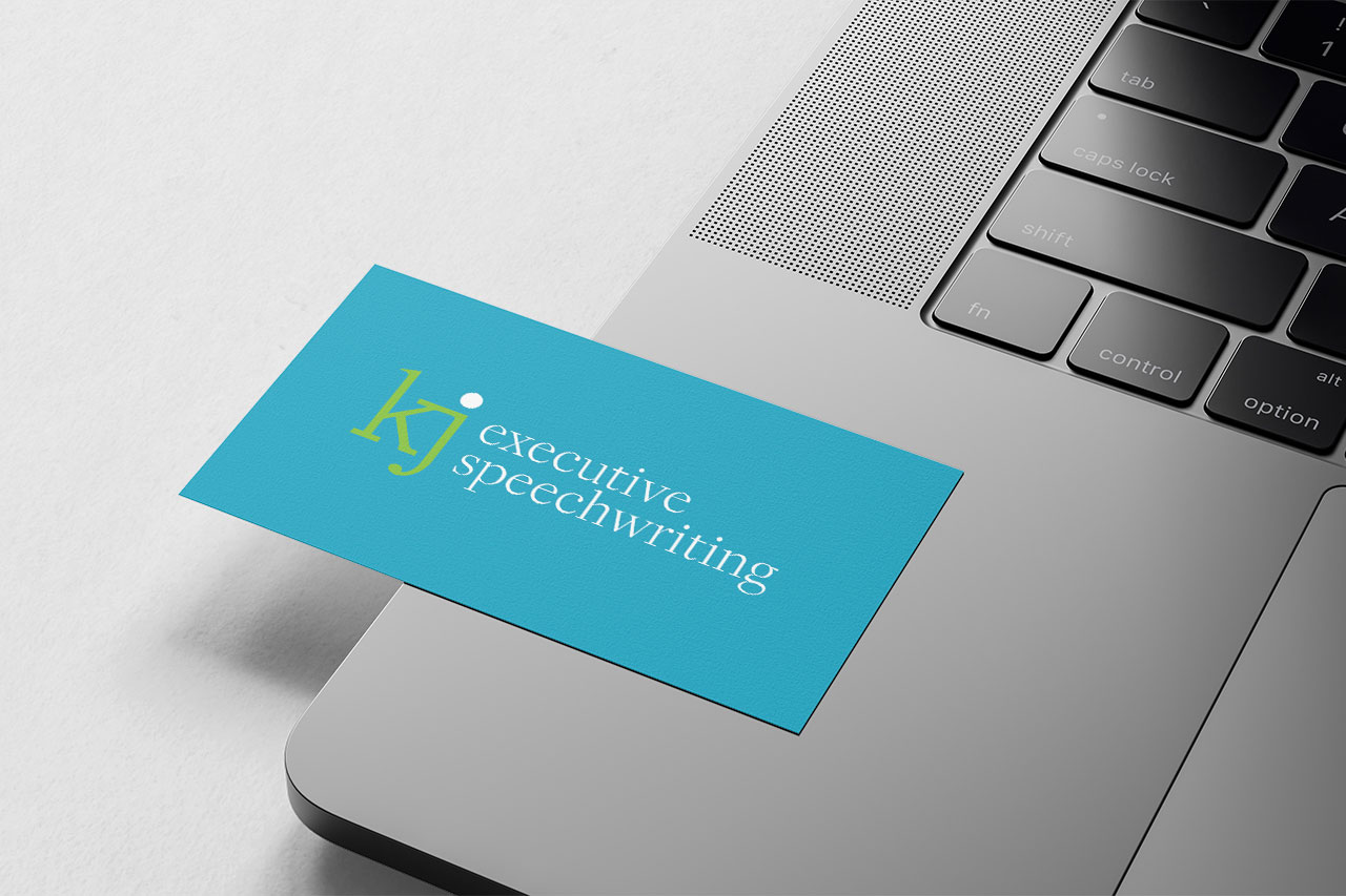 blue business card on a silver laptop