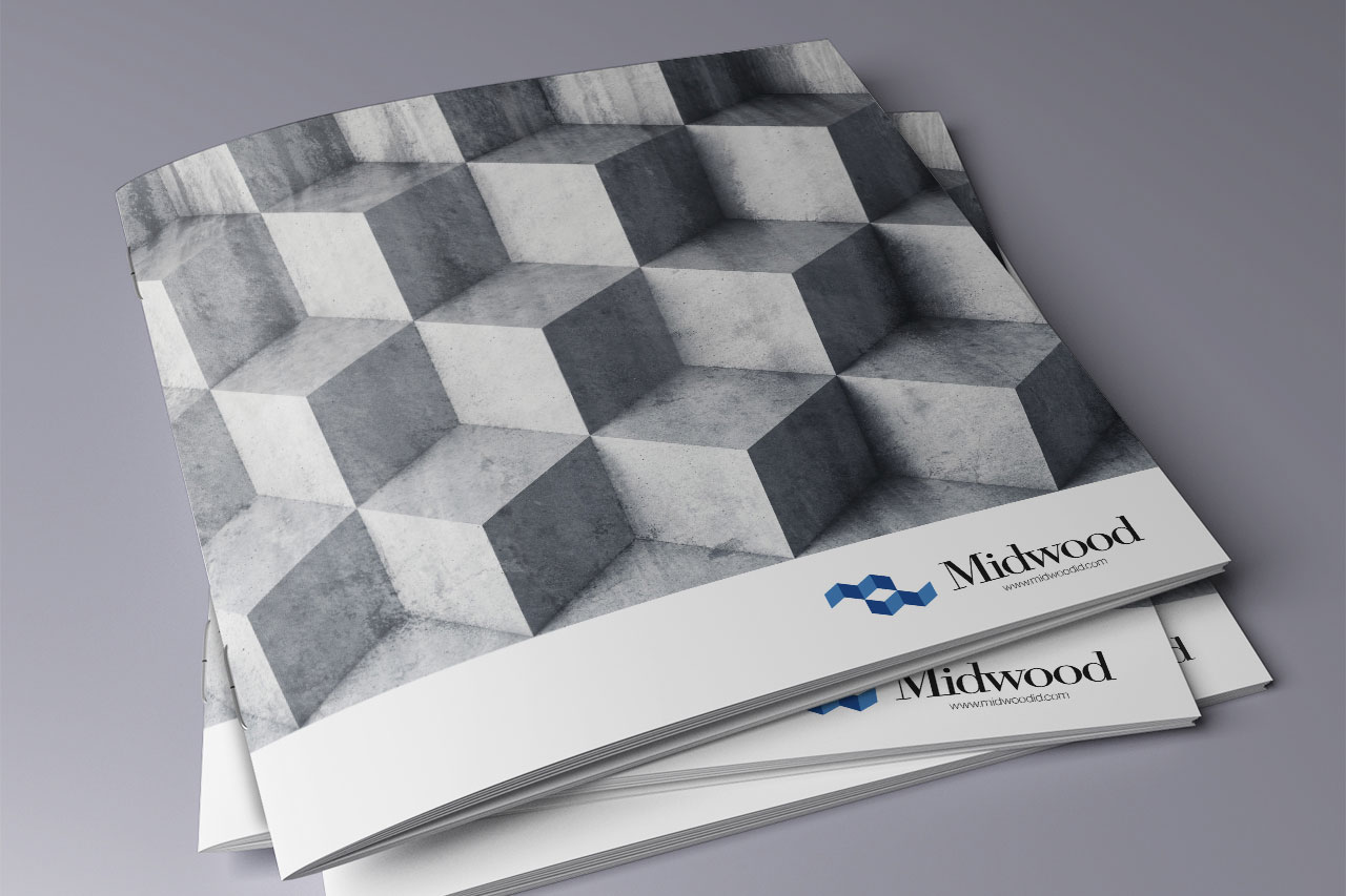 three stacked brochure covers with gray blocks
