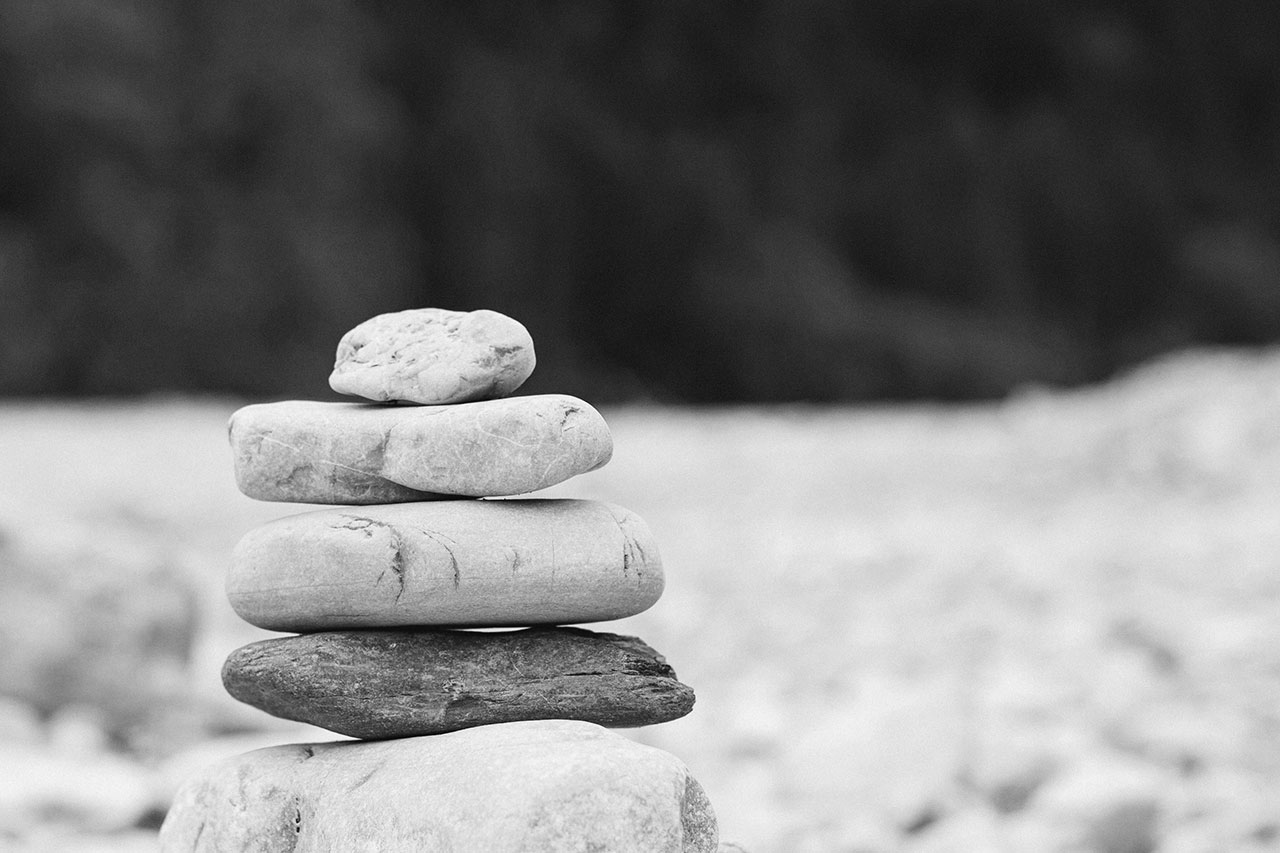 stack of rocks in black and white