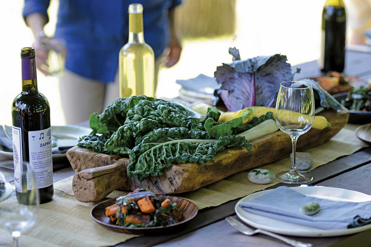 table setting outdoors with kale and colorful vegetables