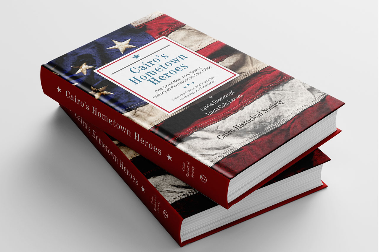 stack of two hardcover books with flag