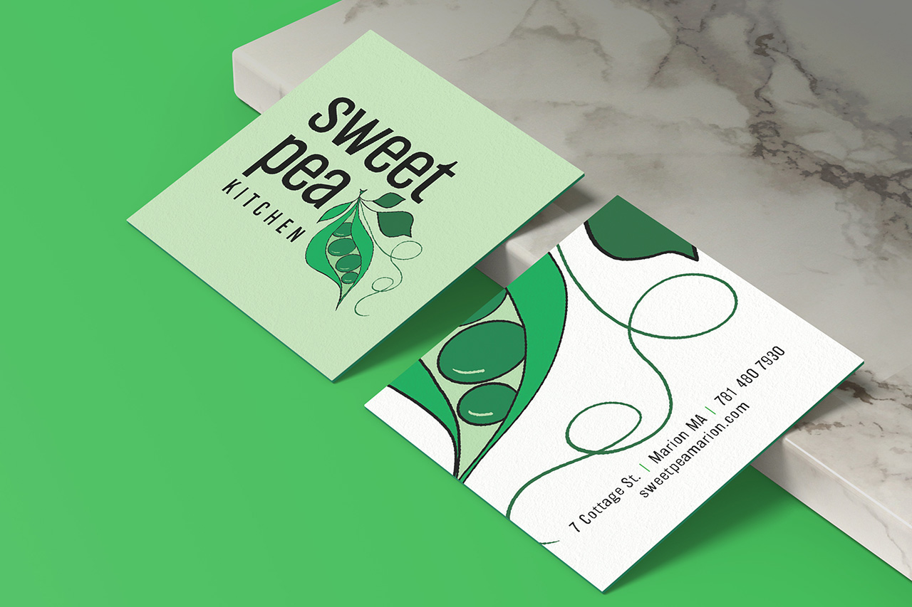 square business cards leaning on a marble slab